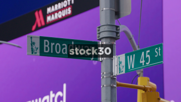 Street Sign And Wide Shot Of Broadway And West 45th Street In New York City, USA
