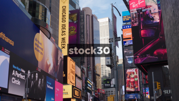 Wide Shot Of Neon Signs In Times Square New York City, USA