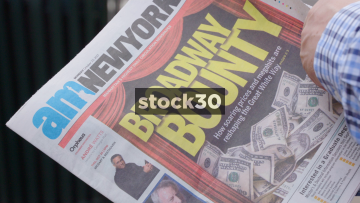 Man Flicking Through Copy Of AM New York Newspaper, USA