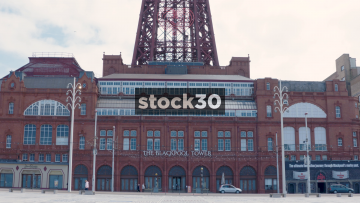 Blackpool Tower Building Wide Shot With Vintage Tram Passing, UK