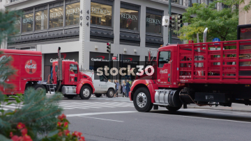 Two Coca Cola Trucks Passing Near Capital One Bank On 5th Avenue New York, USA