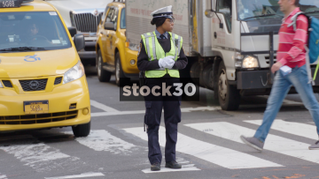 NYPD Traffic Cops At Busy Junction On 5th Avenue In New York, USA