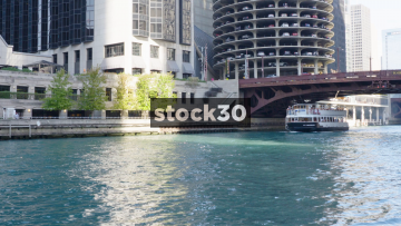 A Boat Passing On Chicago River By Dearborn Street, USA