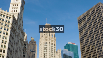 The Tribune Tower And US Flag In Chicago, USA
