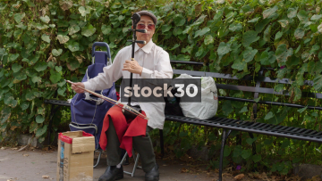 Chinese Man Playing Traditional Erhu Instrument In New York, USA