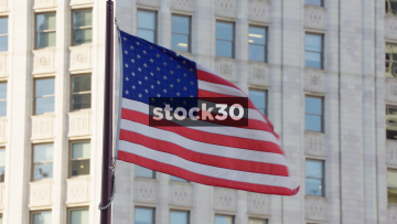 A Slow Motion Shot Of The USA Flag Flying In Chicago, USA