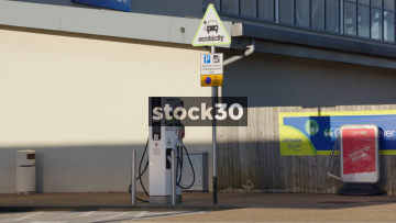 Electric Vehicle Charging Point Wide Shot And Signage, UK