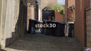 Residents Putting Dustbins Out In Blackburn, UK
