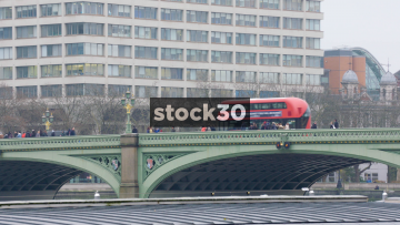 Westminster Bridge In London With Passing Traffic And Pedestrians, UK