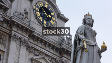Queen Anne Statue And Clock At St.Paul's Cathedral, UK