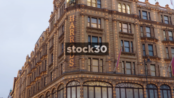Harrods Department Store, Pan Down From Sign To Building Front, UK