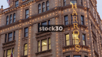 Close Up On Harrods Sign Followed By Focus Pull Then Coat Of Arms, UK