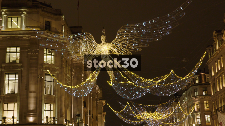 christmas angel decorations on oxford street in london uk stock30