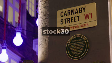 Carnaby Street Sign Followed By Street View At Christmas, UK