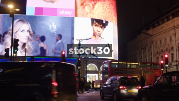 London Piccadilly Circus LED Screens With Passing Taxis And Buses, UK