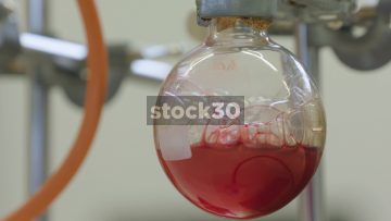 Close Up Shot Of Boiling Coloured Liquid In Chemistry Lab