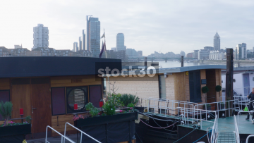 Houseboats moored by Cheyne Walk In Chelsea And The Thames In London, UK