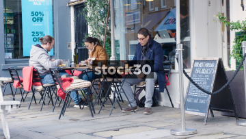 People Eating At A Cafe On Jerdan Place In London, UK