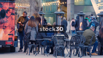 People Sitting Outside By A Drinks Vendor In London, UK