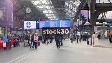 Interior Shot Of Zürich Hauptbahnhof Railway Station With Passengers And Departures Board, Switzerland