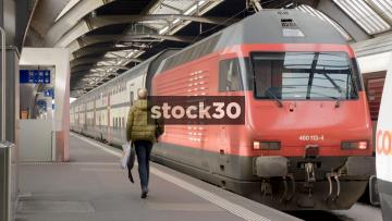 Double Decker Passenger Train Departing From Zurich Hauptbahnhof Railway Station, Switzerland