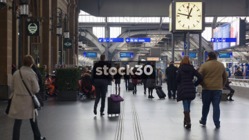 Interior Shot Of Zürich Hauptbahnhof Railway Station, Switzerland Showing Clock And Pedestrians