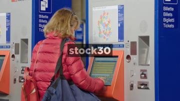 Woman Using Ticket Machine At Zürich Hauptbahnhof Railway Station, Switzerland
