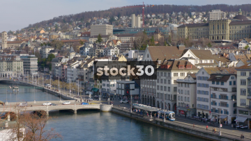 Wide Shot Of Limmat River And Limmatquai In Zürich. Trams Passing, Switzerland