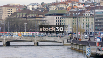 Limmat River And Limmatquai In Zürich With Passing Trams, Switzerland