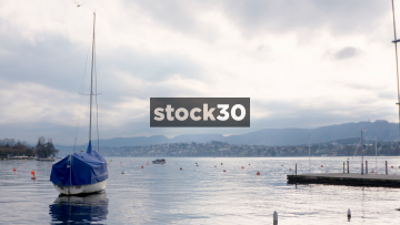 Wide Shot Of Lake Zürich With Boat And Buoys, Switzerland