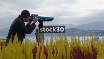 Man Using Telescope At Lake Zürich, Switzerland