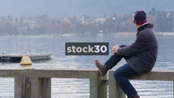 Man Looking Out Over Lake Zürich, Wide Shot, Switzerland