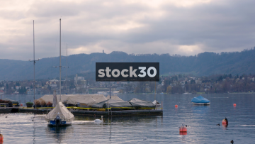 View Over Lake Zürich WIth Boats And Buoys, Switzerland