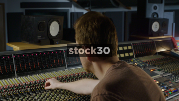 Man In Recording Studio Mixing With Neve VR Legend Analog Console