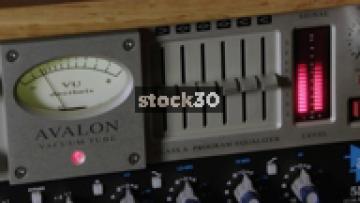 Avalon Vacuum Tube Audio Compressor Being Adjusted In Recording Studio