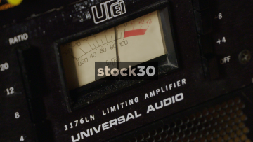 Universal Audio 1176LN Limiting Amplifier Being Adjusted In Recording Studio