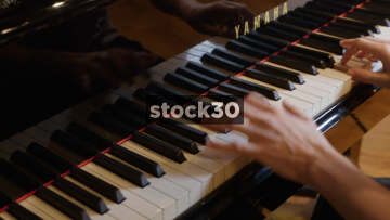 Close Up Shot Across Keys Of Mans Hands Playing Yamaha Grand Piano