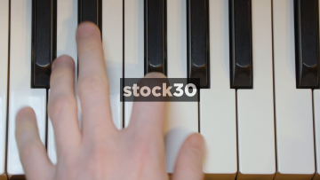 Close Up Overhead Shot Of Mans Hands Playing Yamaha Grand Piano