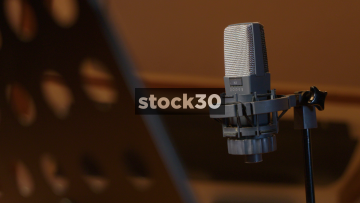 Man Connecting AKG C414 Condenser Microphone In Recording Studio