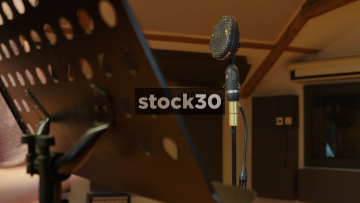 Man Connceting Vintage BBC Coles 4038 Ribbon Microphone In Recording Studio