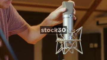 Man Connecting Neumann U87 Condenser Microphone In Recording Studio