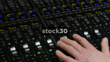 Various Close Up Shots Of Hands Operating Faders On Avid S6 Control Surface