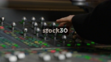 Hands Operating Avid ICON D Control Surface In Recording Studio