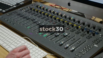 Hands Adjusting Eq On Master Module Of Avid S6 Control Surface Stock30