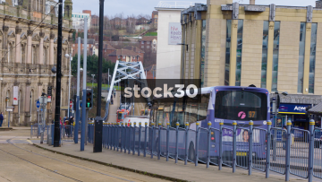 Commercial Street In Sheffield With Traffic And Tram, UK