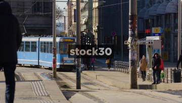 Tram Departs From Platford And Another Arrives In Olso, Norway