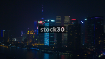 Nighttime View Over Huangpu River Towards Skyscrapers In Pudong Shanghai, China