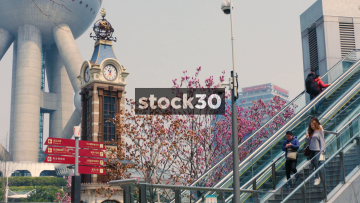 The Disney Clock Tower And Tourist Directions Sign In Shanghai, China