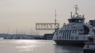 Moored Boats And Ferry At Aker Brygge In Oslo, Norway