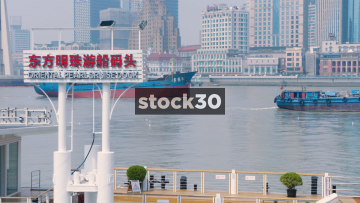 Ships Passing By The Oriental Pearl Cruise Dock In Shanghai, China